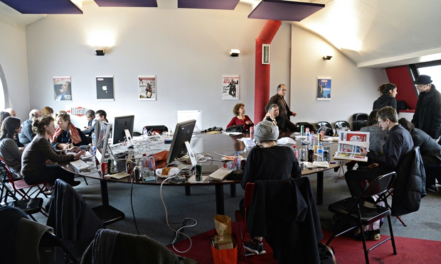 A photo of the Charlie Hebdo staff working on the edition.